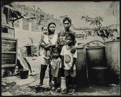 An old prayer that is leaning by Lawrence Sumulong. A wet-plate ambrotype of one of the 60 Filipino families were forced to move into Leyte Provincial Jail after being left homeless and destitute by Typhoon Haiyan. Photo supplied by the artist.